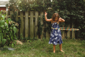 Child playing with hulahoop