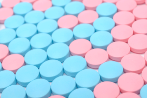 pink and blue coloured pills
