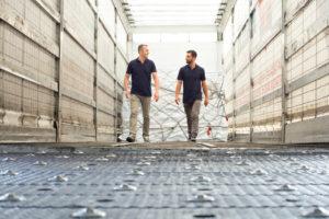 Two men walking at work