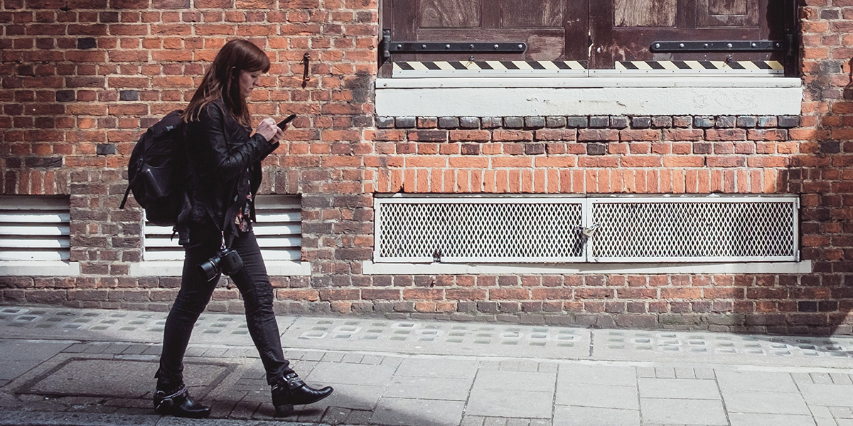 Woman walking with a phone