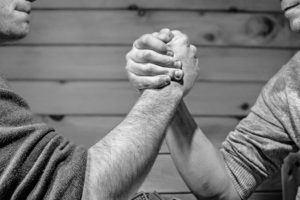 Arm wrestle black and white