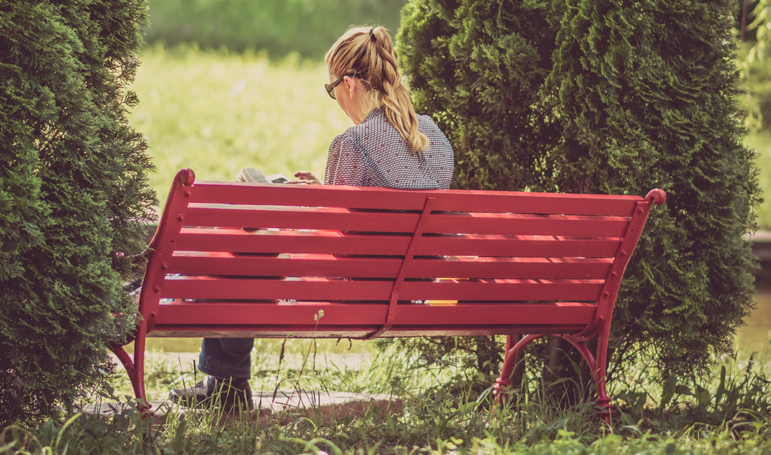 girl on red park bench