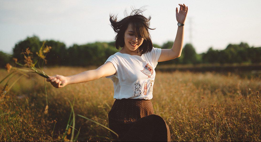 Happy lady in a field