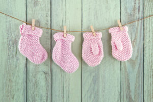 pink mittens and booties