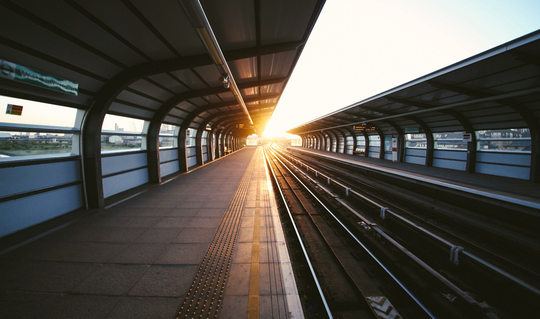 train line with sun setting