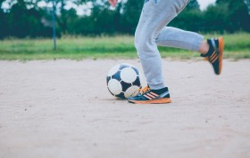 Kicking soccer ball
