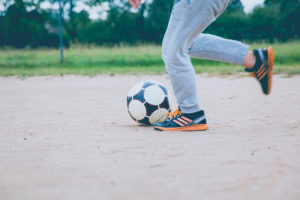 Kicking soccer ball