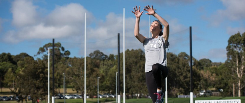 A woman footballer in training.