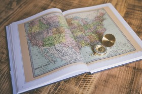 Open atlas on table.