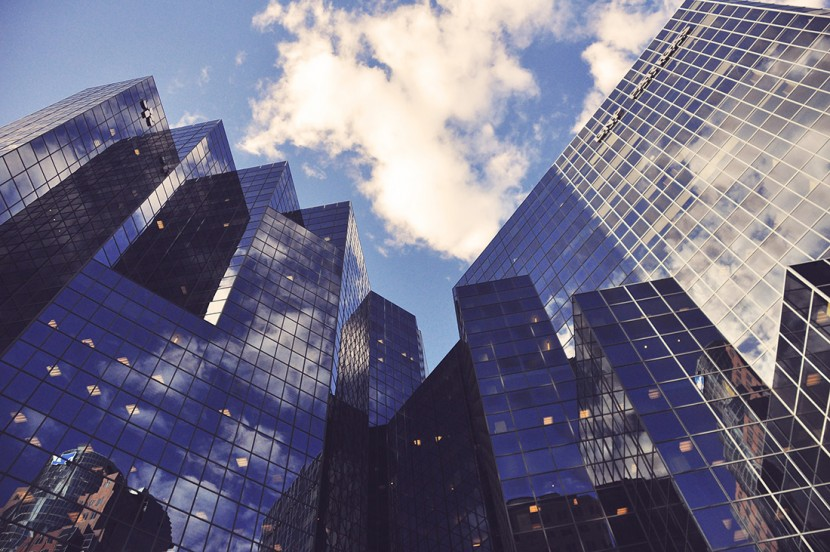 Upward view of city buildings.