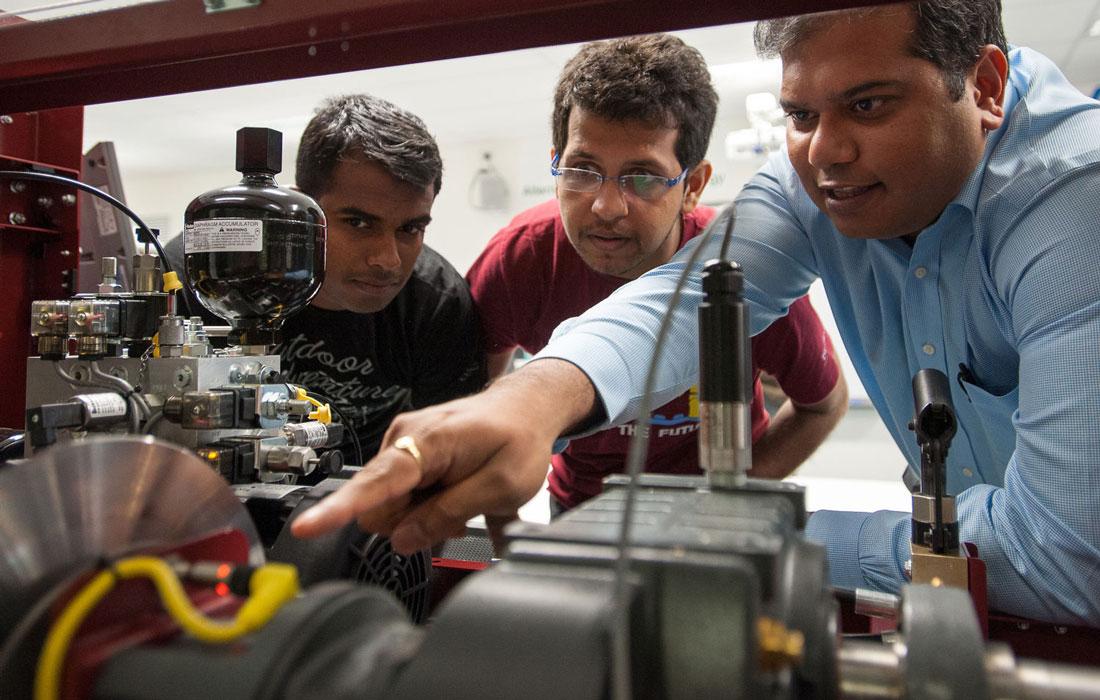 engineers-looking-at-machinery