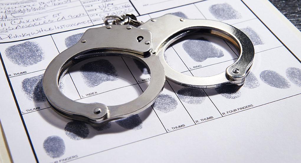 Handcuffs and fingerprints of a suspect.