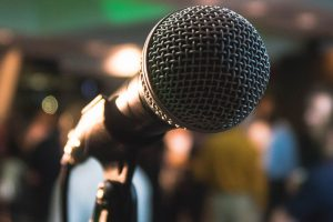 microphone-with-audience-in-background-2