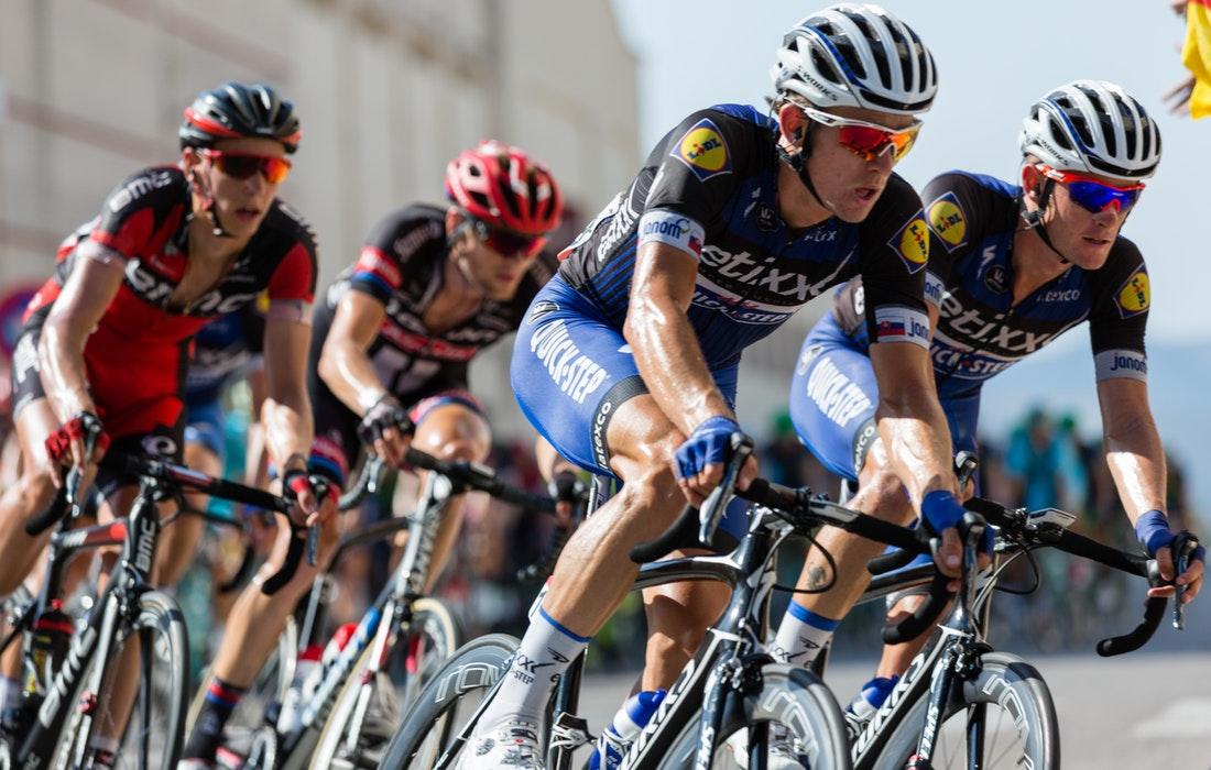 Cyclists racing on road bikes