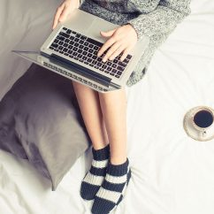 Young woman on laptop online shopping.