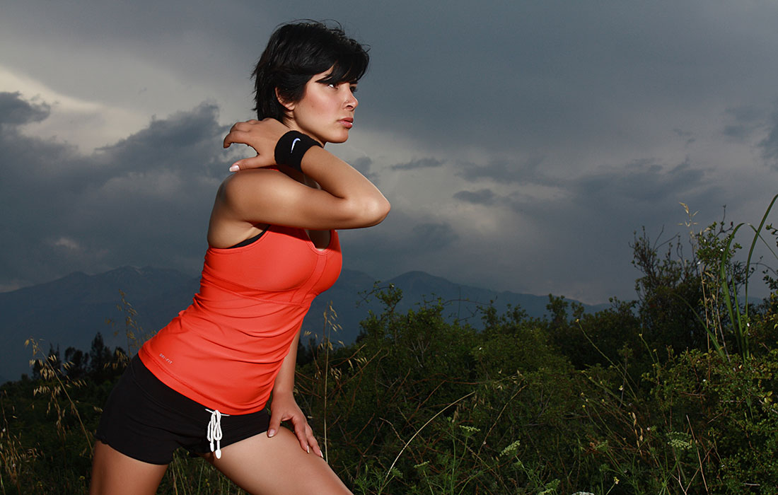 woman exercising one arm