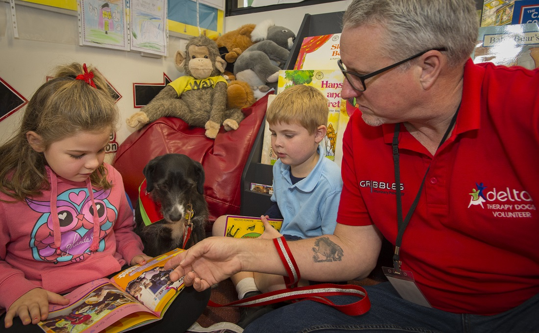 Children reading to dog in classroom