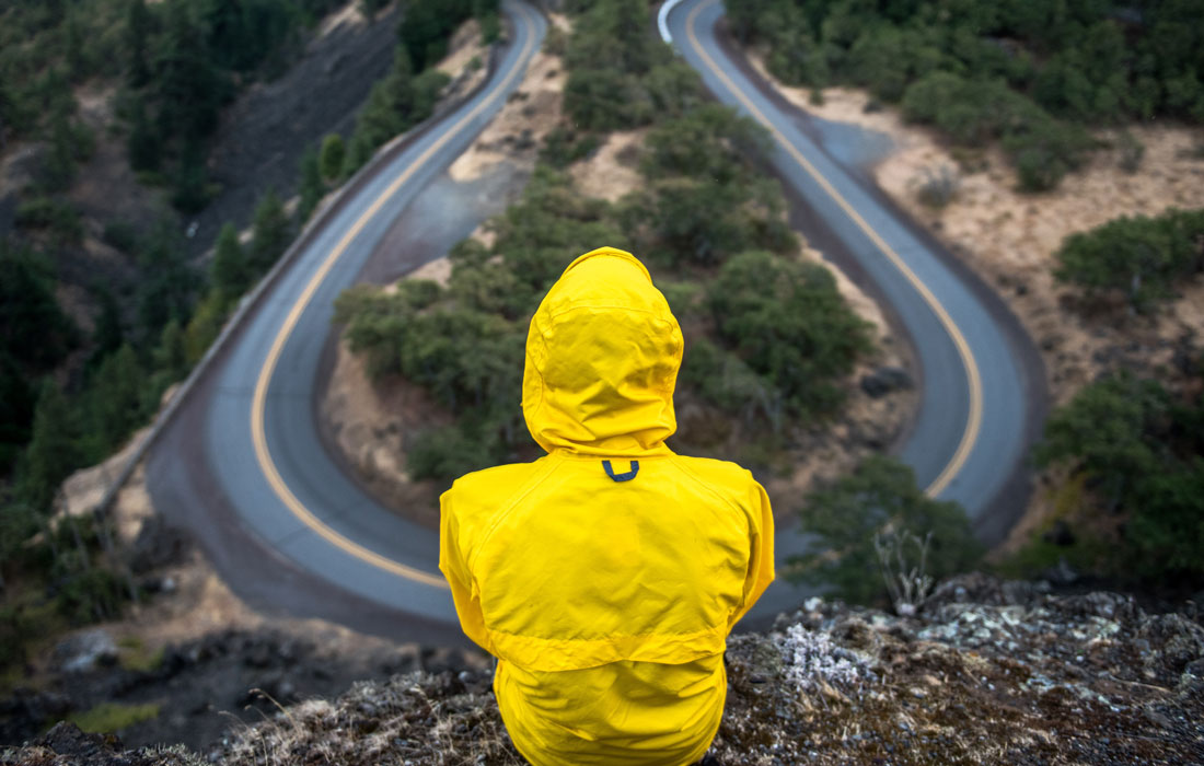 man observing winding road