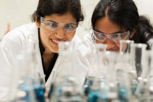 Two girls observing chemicals