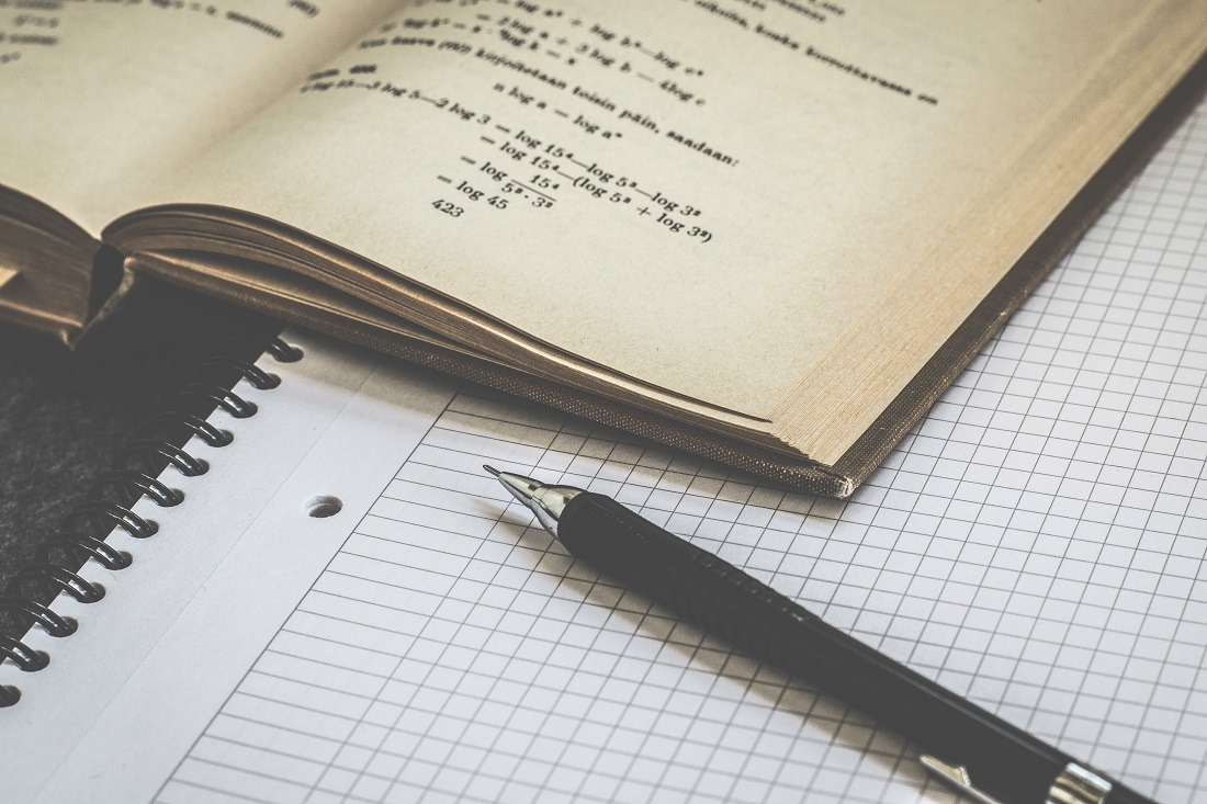 Maths equations and a notebook