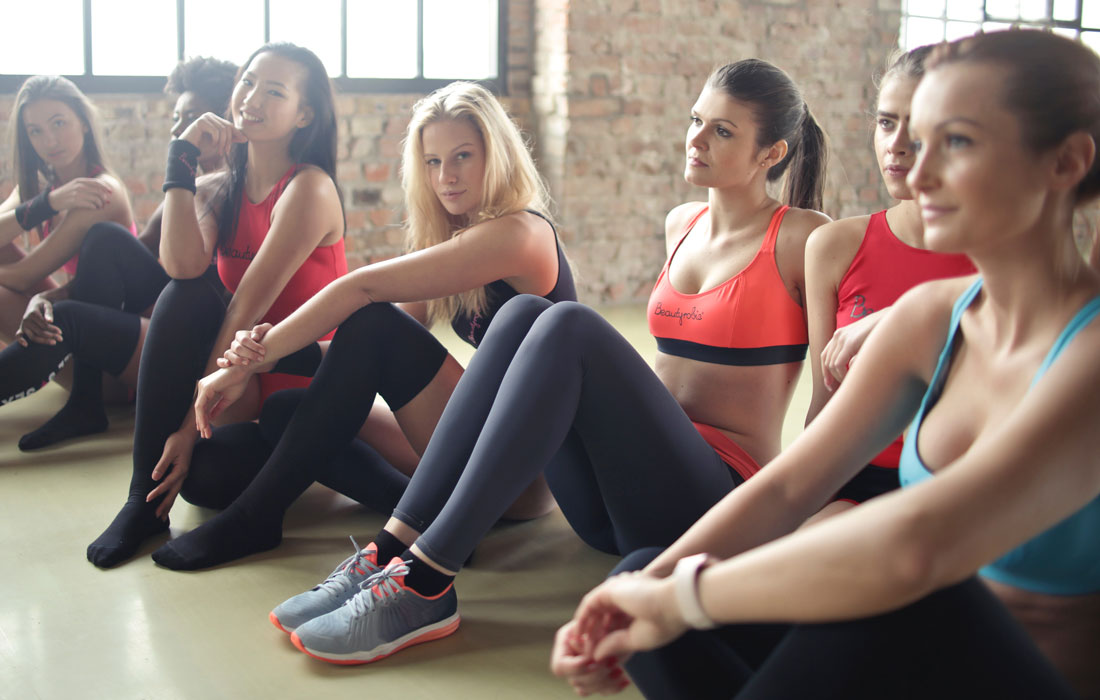 women sitting in activewear