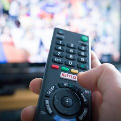 remote control pointing to TV