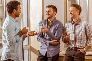 three men chatting at work