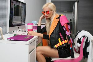 woman at computer wearing fashion jacket