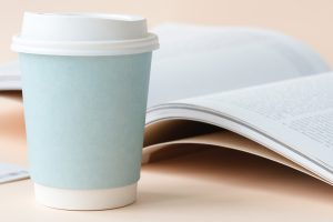 Aesthetic blue coffee cup and book