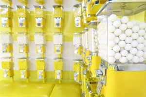 White and yellow gumball machines