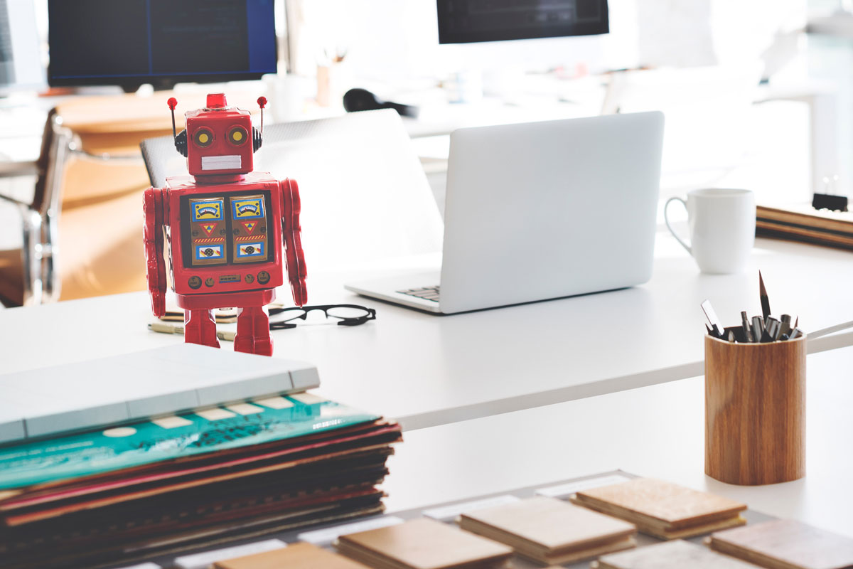 robot and computer on desk
