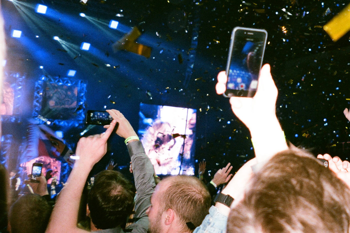 audience at concert holding up smartphones