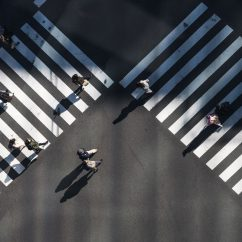 people walking on road crossing