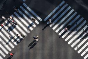 people walking on road crossing