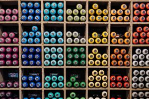 coloured paint tubes in compartments