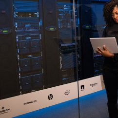 women standing in front of computer server