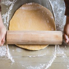 Person rolling bread dough