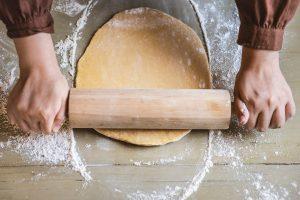 Person rolling bread dough