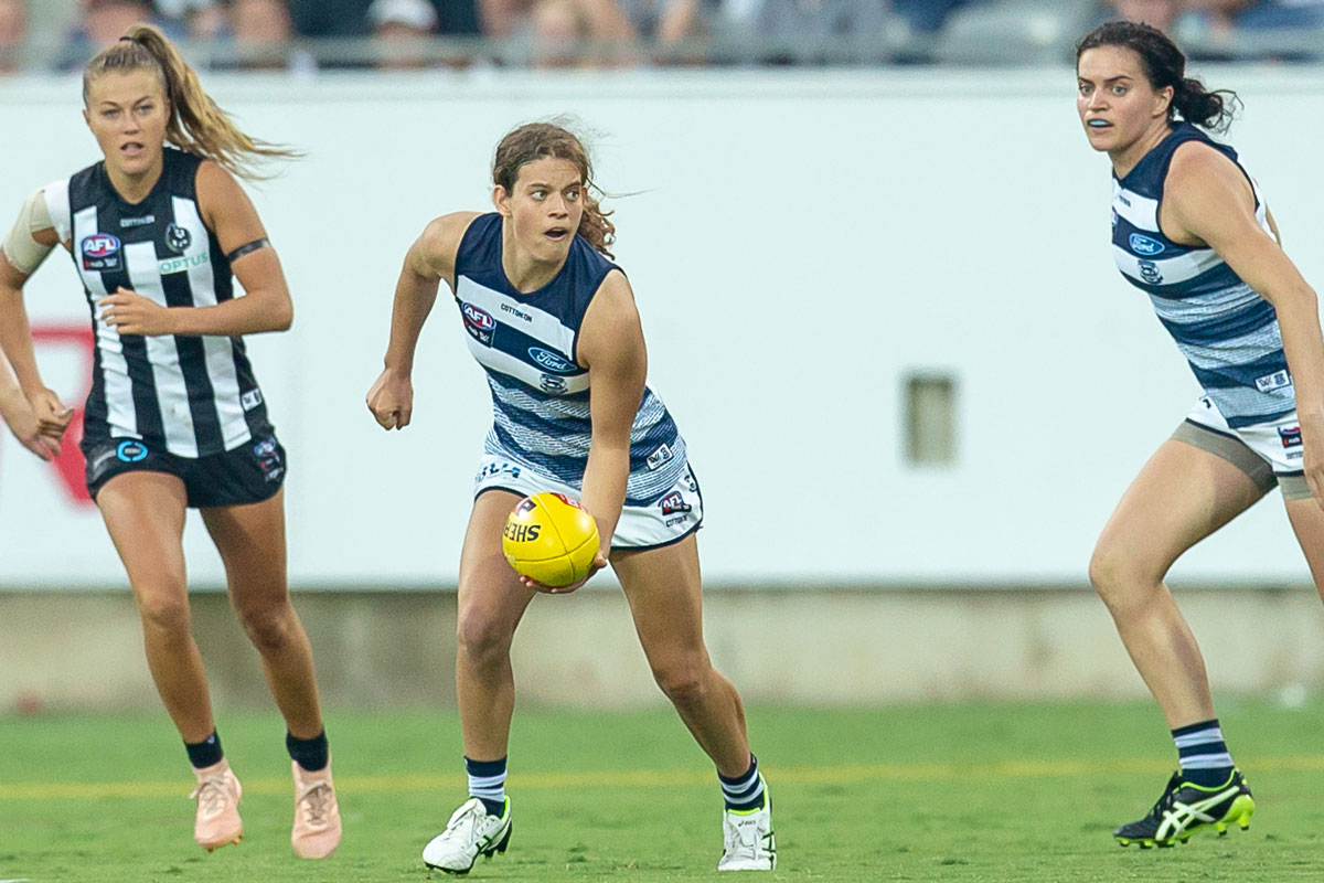 nina and two other players on the footy field