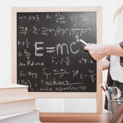 Chalkboard covered in maths equations