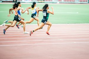 Four sprinters in a race