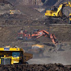 excavators at a mining site