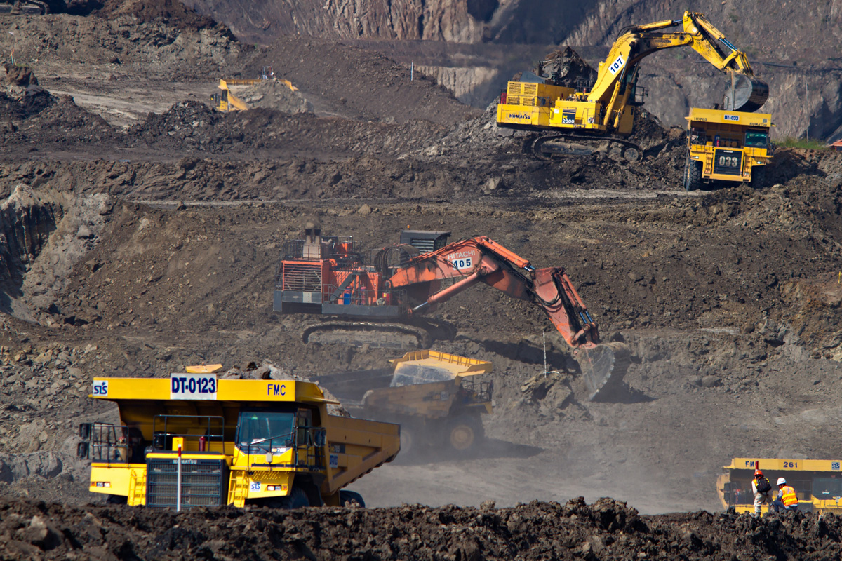 excavators at a mining site