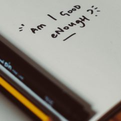 Am I good enough written on a notebook