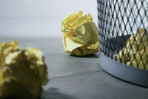 Scrunched up paper in a bin