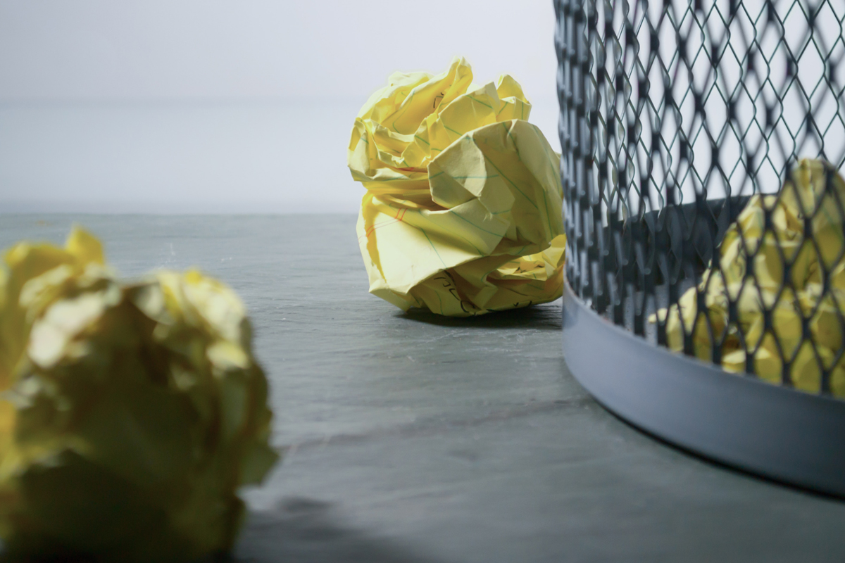 Scrunched up paper in a bin