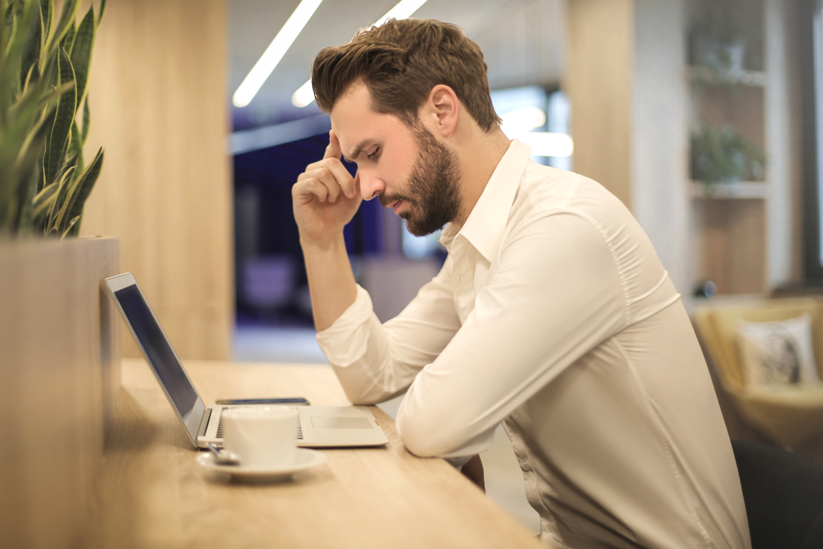man looking frustrated at work