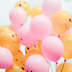 orange and pink smiling balloons