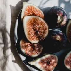 Halved figs on a plate