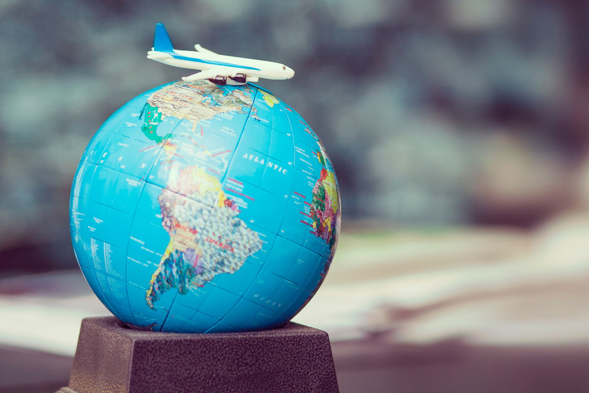 Toy plane on top of a world globe